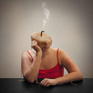 Image of woman with burnt out candle for a head representing workplace burnout